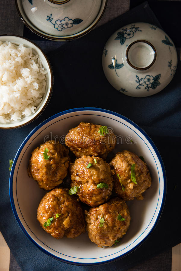 Asian Meatballs Served with White Rice. Asian Meatballs placed in a big bowl, served with white rice stock images