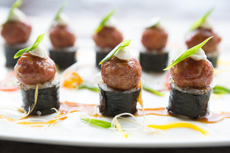 Asian meatballs snack. Served on a big white plate royalty free stock image