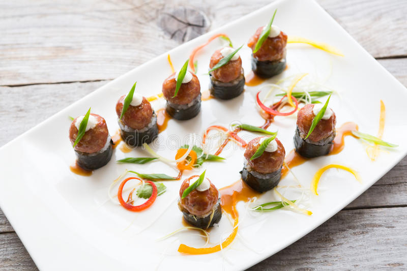 Asian meatballs snack. Served on a big white plate royalty free stock photo