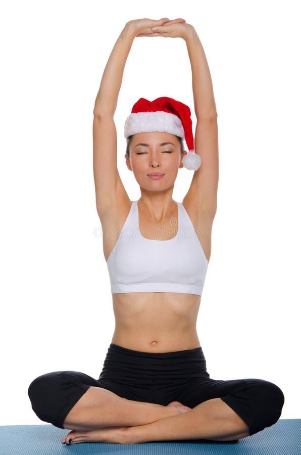 Asian meditating in a cap of Santa. Claus royalty free stock images