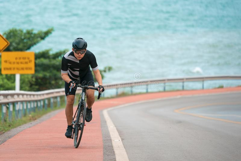 Asian men are cycling road bike in the morning. Asian man are cycling road bike in the morning1 royalty free stock image