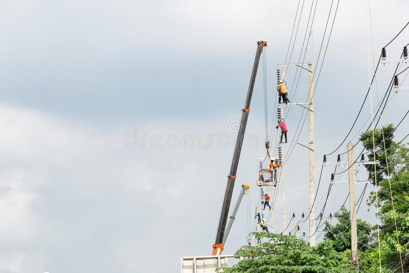 High voltage. Asian men engineering working on high voltage workfield at countryside royalty free stock image