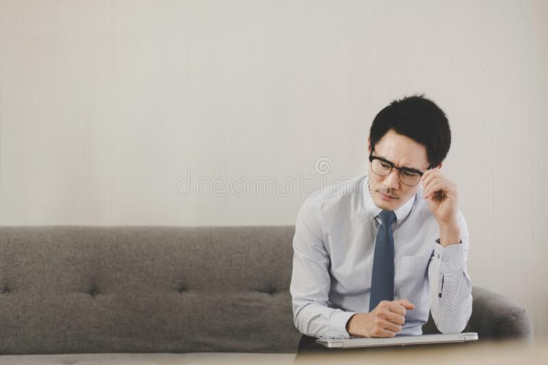 Asian man feeling so stressed and tired frustrated failure exhausted,Unemployed concept royalty free stock photography