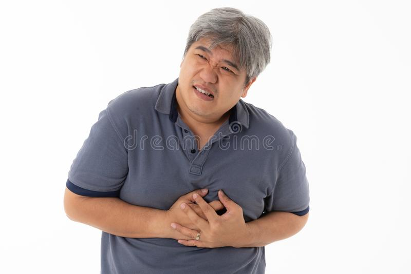 Asian middle-aged man, are suffering from angina Due to heart disease stock photo