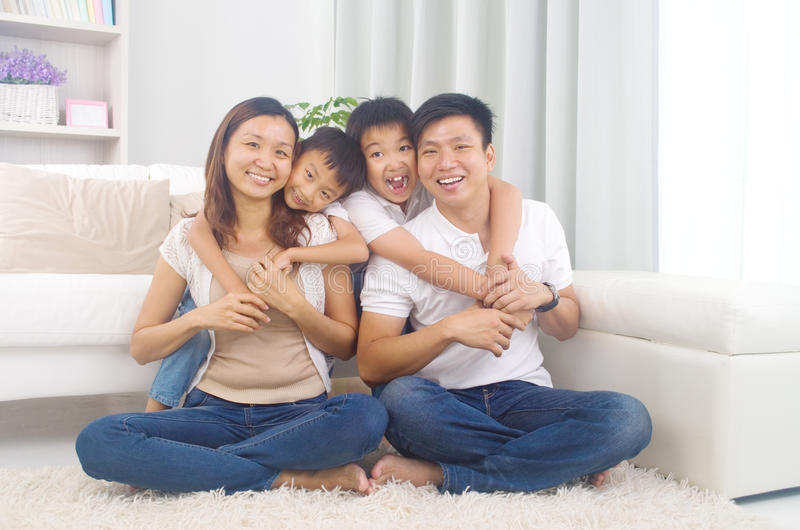 Asian mixed race family. Indoor portrait of asian mixed race family royalty free stock photo