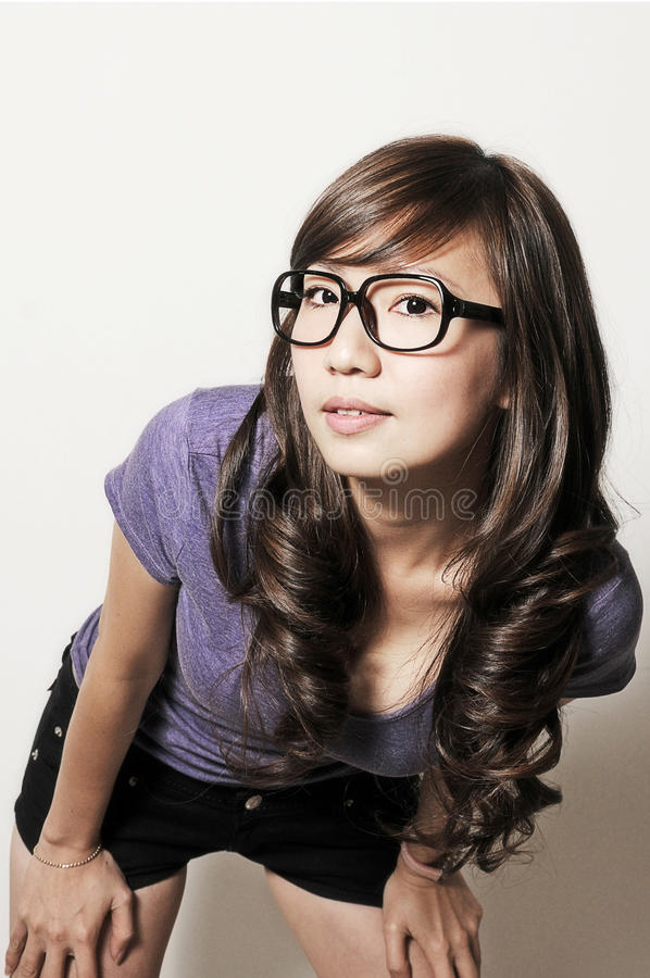 Asian model. Beautiful Asian Chinese Model posing with glasses stock images
