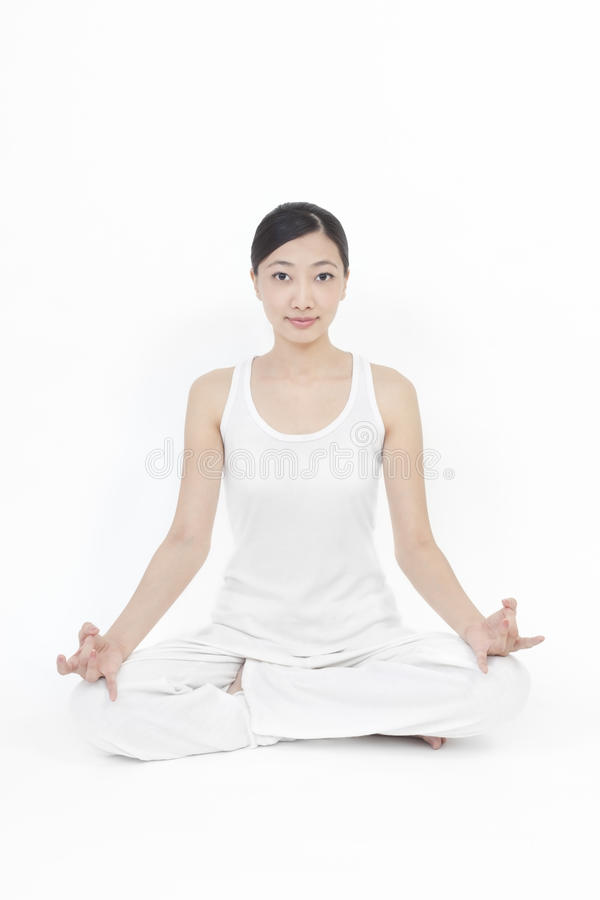 Download Asian model doing yoga stock image. Image of clothing - 16479815