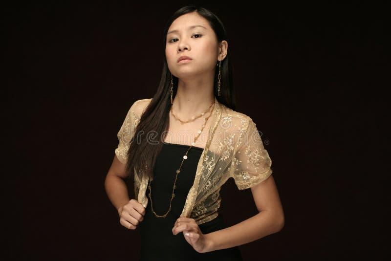 asian model formal dress dark brown background stock photography