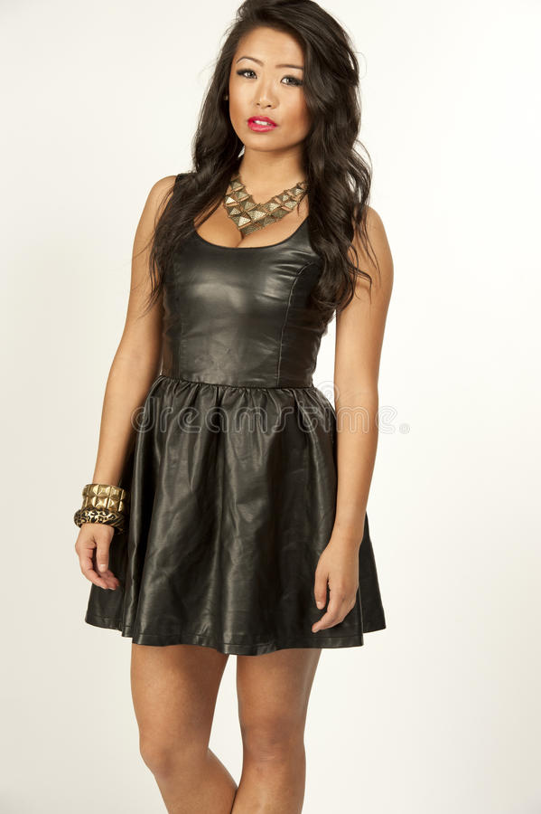 Asian Model In A Leather Dress Stock Photo