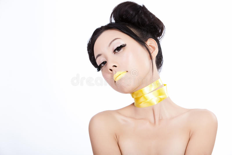 Asian model with yellow lips and creative hair royalty free stock photos