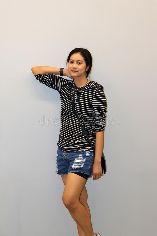 Asian modern woman in white and black stripes color of long-sleeved T-shirt. Asian modern woman in white and black stripes color of long-sleeved T-shirt stock image