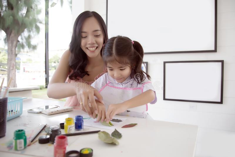 Asian mother and daughter painting water color royalty free stock photo