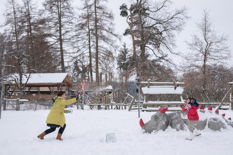 Asian mother and daughter playing with snow, Switzerland, Europe stock photography