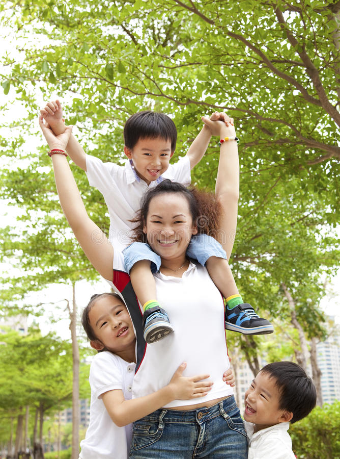 Asian Mother with her daughter and son. Happy Asian Mother with her daughter and son royalty free stock photo