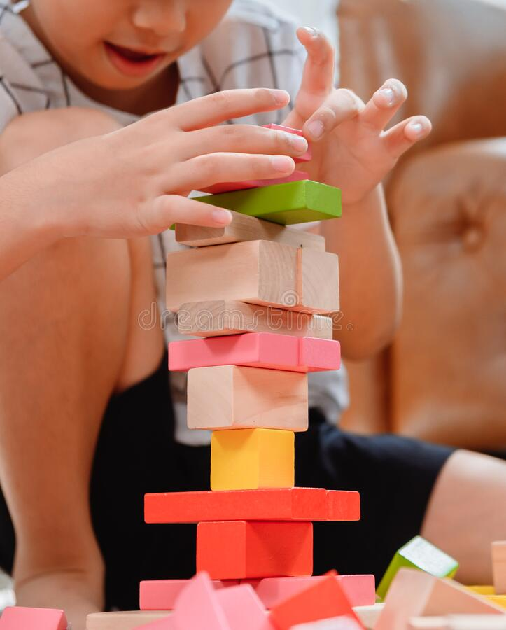 Free Asian Mother Work Home Together With Son. Mom And Kid Play Color Wooden Block. Child Creating Building Toy. Stock Image - 191058431