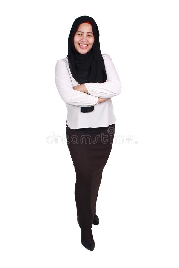 Muslim woman Smiling Friendly. Asian muslim businesswoman wearing hijab smiling friendly with arms crossed, young woman standing isolated on white, full body stock photos