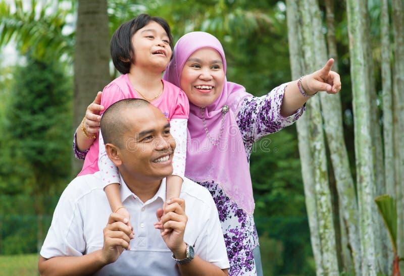 Asian Muslim family outdoor stock photos