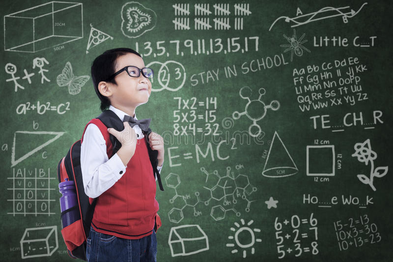 Asian nerd boy with backpack in class royalty free stock photos