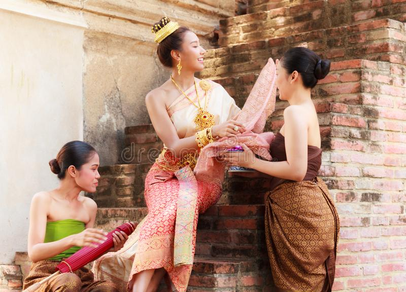 Asian noble beauty with maids dressed in traditional clothes shopping in old retro historical period theme.  royalty free stock photo