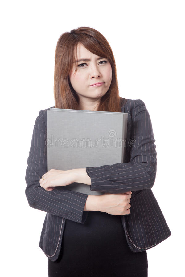 Asian office girl unhappy hold a folder in her arms. Isolated on white background stock images