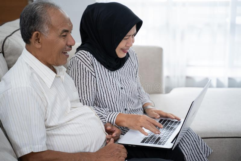 Asian old couple together using laptop royalty free stock photography