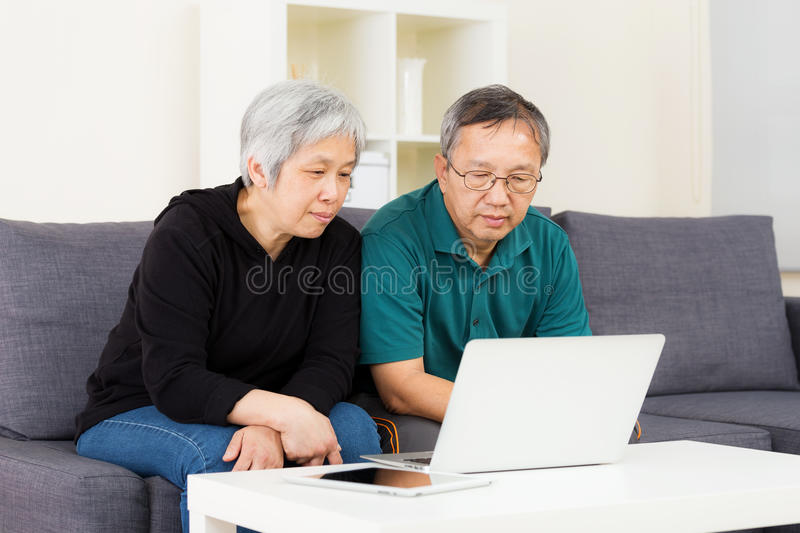 Asian old couple using laptop royalty free stock photos
