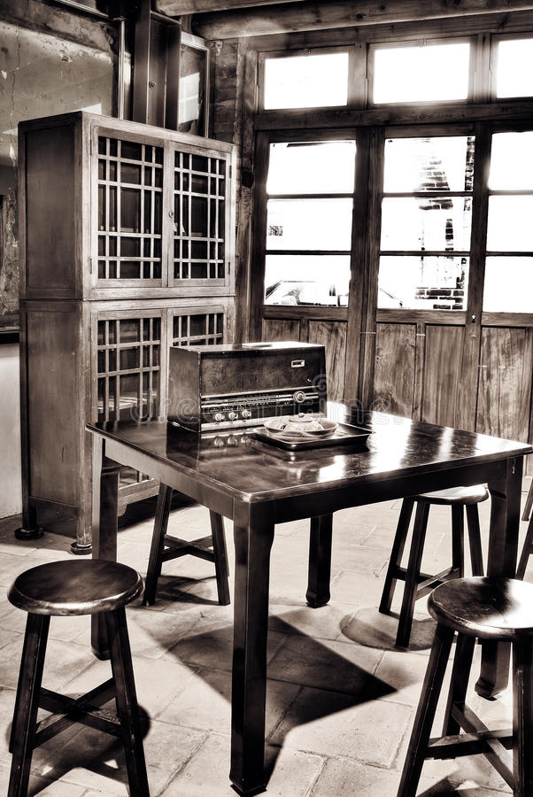 Asian old house interior. With circle wooden chair and antique radio on desk royalty free stock photography