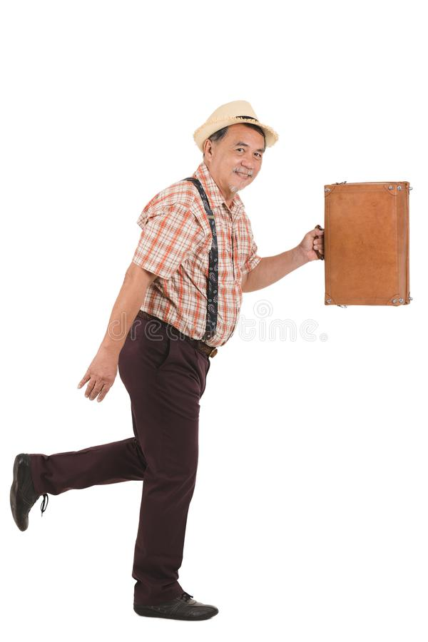 Asian old man hold suitcase stock image