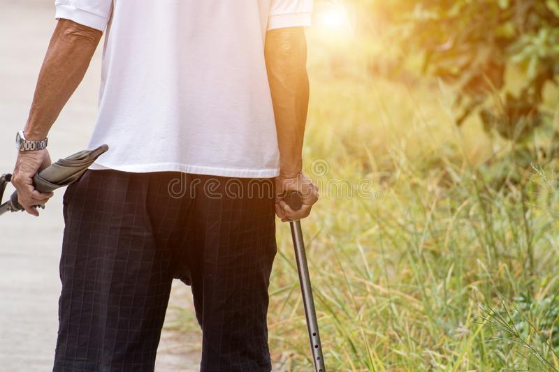 Asian old man with walking stick or staff cane for patient or senior or elderly people at the front house,healthy medical concept. Hand, holding, dementia royalty free stock photography