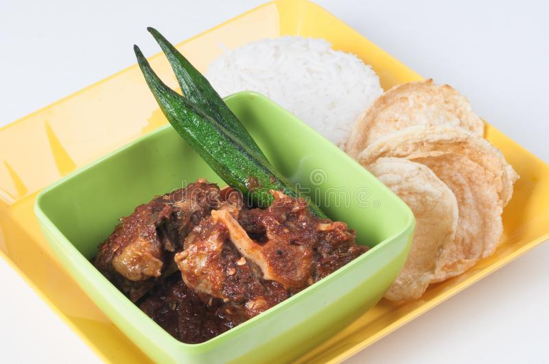 Asian Oxtail Tamarind Curry. With tapioca crackers and white rice stock images