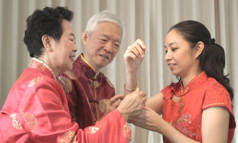 Asian parents give daughter in law gold bracket Chinese New Year stock photography