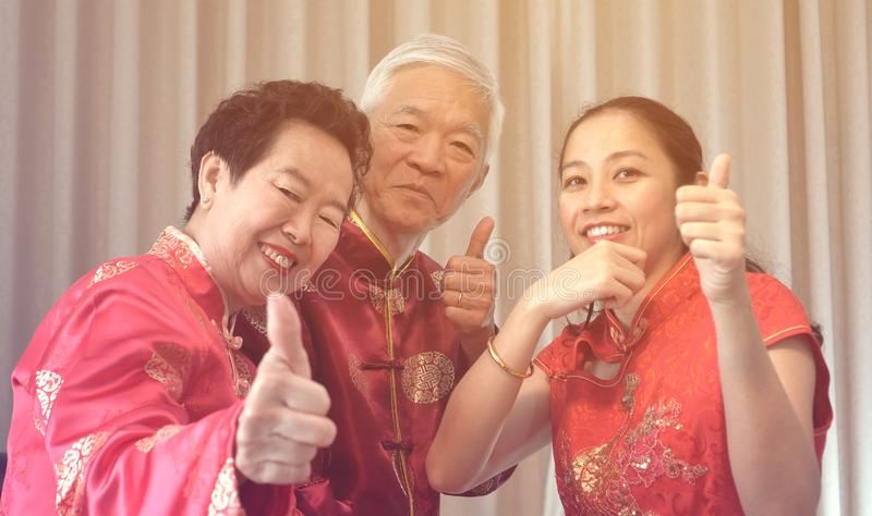 Asian parents give daughter in law gold bracket Chinese New Year stock photo