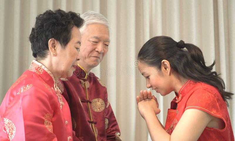 Asian parents give daughter in law gold bracket Chinese New Year stock photos
