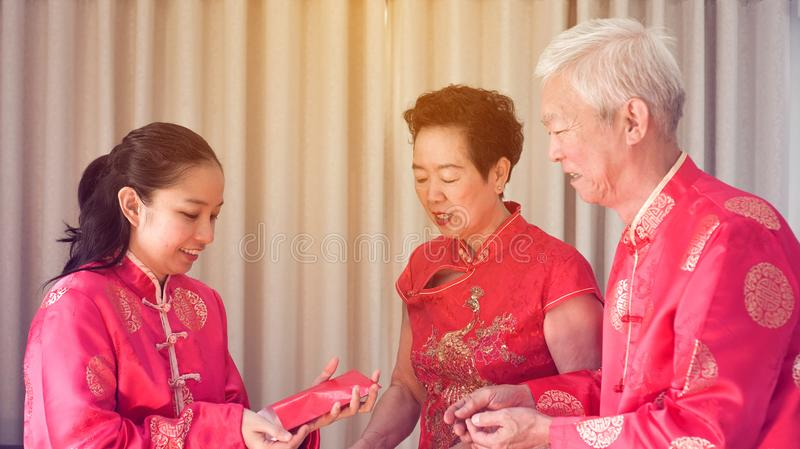 Asian parents give red envelop to daughter Chinese New Year royalty free stock photos