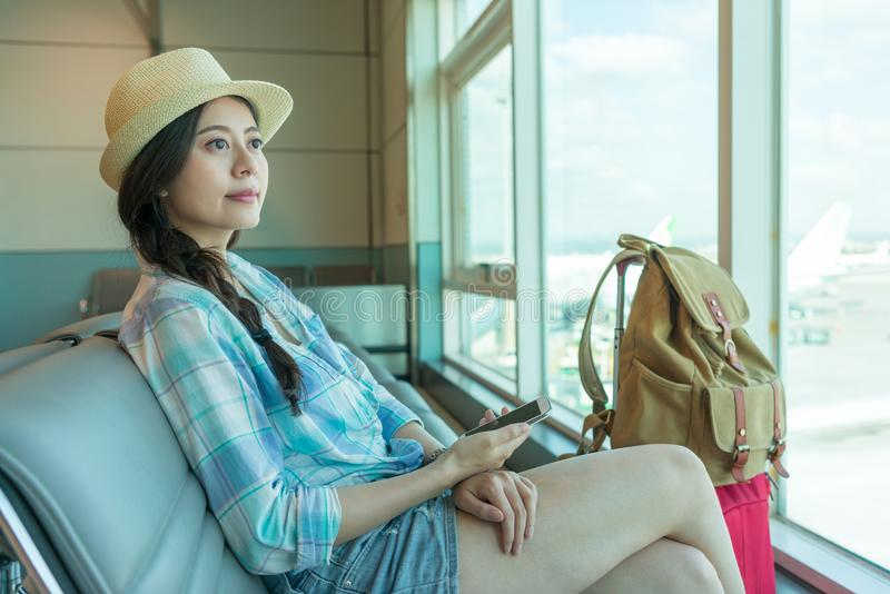 Asian passenger in the airport waiting royalty free stock image