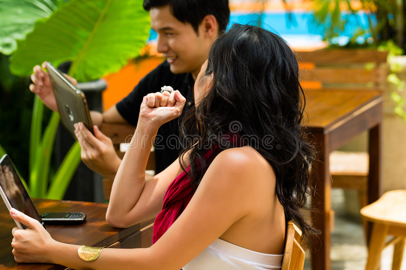 Asian people in cafe with computer stock photo