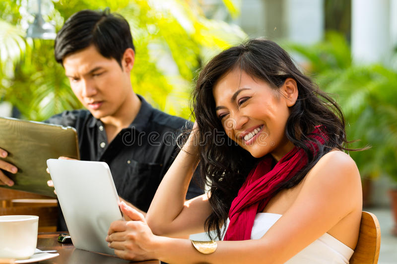 Asian people in cafe with computer stock photography