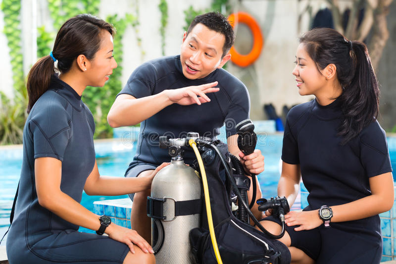 People in a diving school royalty free stock images