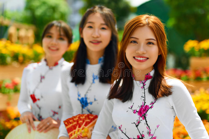 Asian People. Happy Women Wearing National Traditional Clothing. stock photos