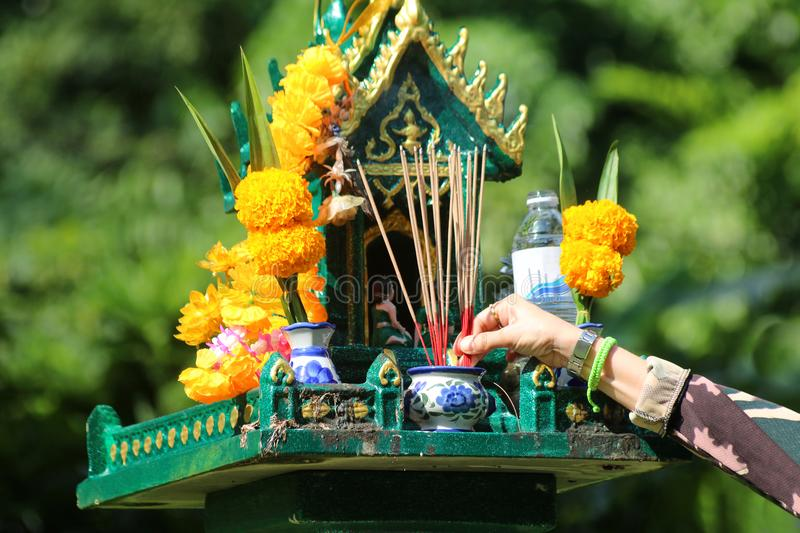 Asian people with incense pay respect to shrine or spirit worship. Asian people pay respect to shrine of the household god or spirit worship, Incense and stock photography