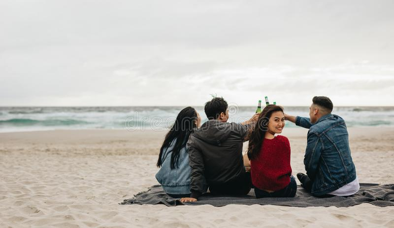 Asian people partying on the beach royalty free stock image