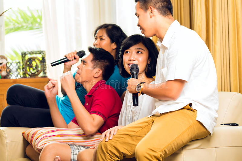 Download Asian People Singing At Karaoke Party Stock Photo - Image: 27225168