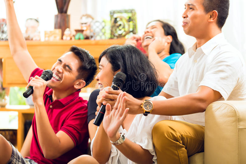 Asian People Singing At Karaoke Party Stock Images