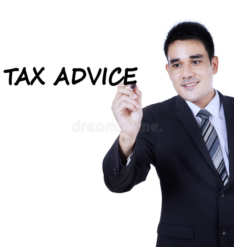 Asian person writes tax advice. Portrait of young asian businessman wearing formal suit and writes a text of tax advice on whiteboard royalty free stock image