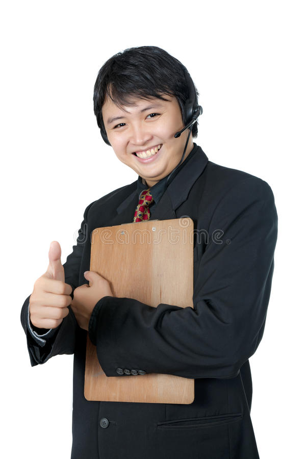 Asian Phone Operator Thumb Up Royalty Free Stock Images