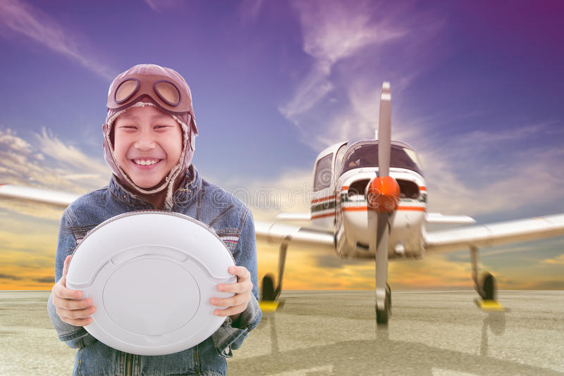 Asian pilot boy with Propeller plane. Parking at the airport royalty free stock photos