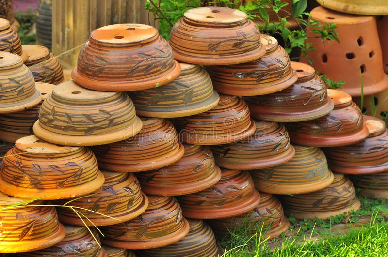 Asian pottery as flower pot stock photography
