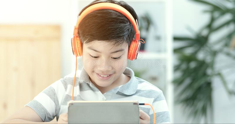 Asian teens playing tablet computer with smile face . royalty free stock photography