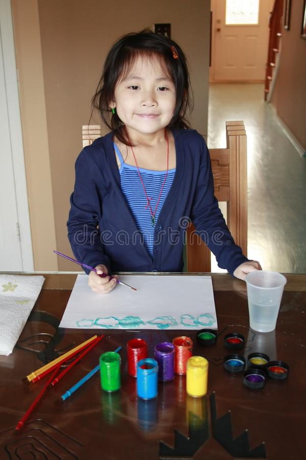 Asian preschooler painting royalty free stock photography