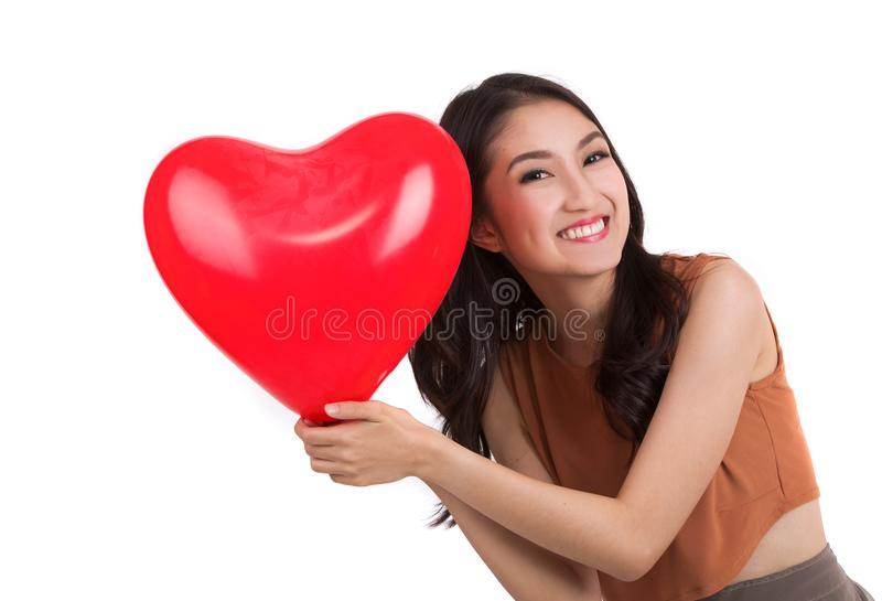 Asian pretty girl and a red heart royalty free stock photography